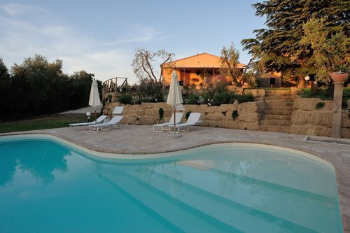 Accommodation Farmhouse with pool among olive trees and vineyard